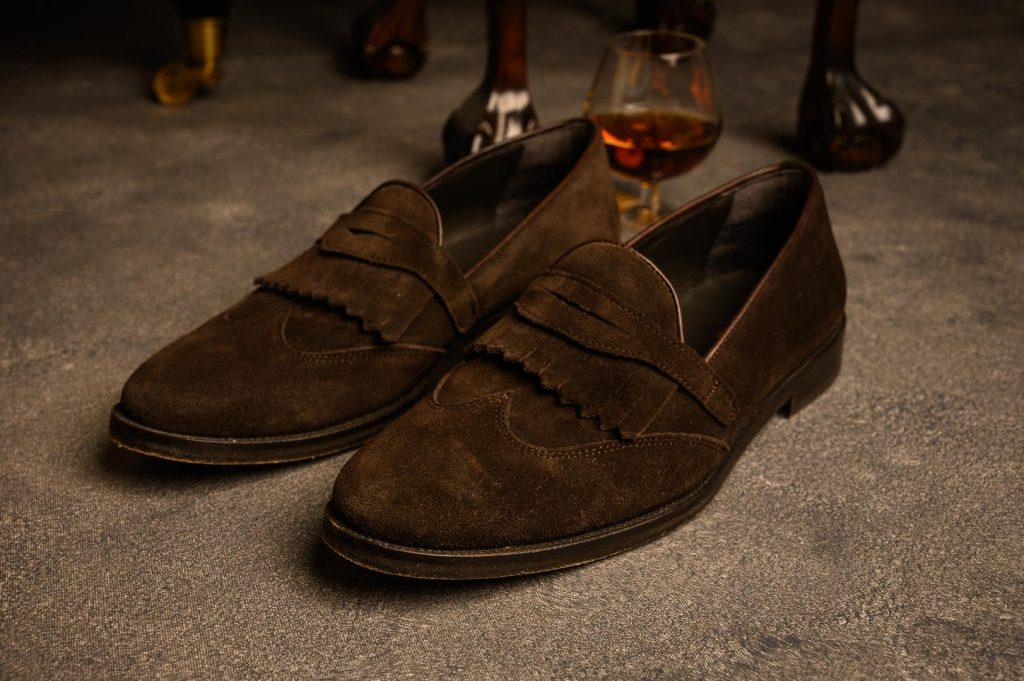 Dark brown suede fringe loafers
