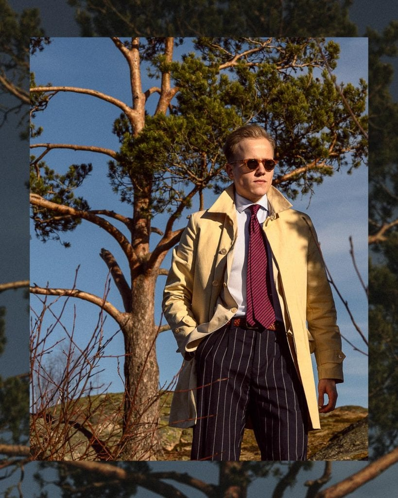 Early-Spring style for men: Trench coat, striped tie, striped trousers, light blue shirt, sunglasses